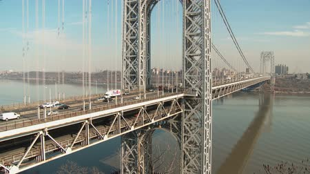 fort lee : NEW YORK - FEBRUARY 13: Afternoon traffic flows over the George Washington Bridge high over the Hudson River between New York and Fort Lee, New Jersey on February 13, 2013 in New York.