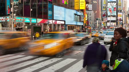 marmeláda : NEW YORK - NOVEMBER 17: (Time-lapsePanningZoom-in) Vehicular and pedestrian traffic move through Times Square at the intersection of 7th Avenue and 44th Street on November 17, 2012 in New York City.