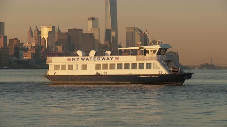 feribot : WEEHAWKEN, NJ - APRIL 4: A NY Waterway ferry arrives at the Port Imperial Ferry Terminal during the morning rush hour from Manhattan on April 4, 2013 in Weehawken, New Jersey.