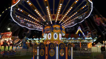 augusta : The colorfully illuminated Chair-O-Planes spins at night during the New Jersey State Fair on August 5, 2014 at the Sussex County Fairgrounds in Augusta, New Jersey.