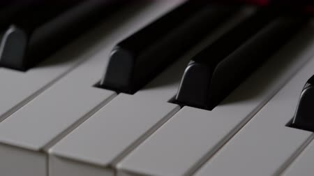 piyano : Close-up of piano keys moving right to left. Stok Video