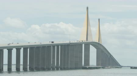 tampa bay : Traffic crosses the Sunshine Skyway Bridge over Tampa Bay as viewed from the north fishing pier.