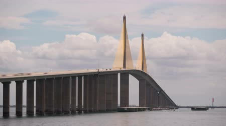 tampa bay : (Time-lapse) Traffic crosses the Sunshine Skyway Bridge over Tampa Bay as viewed from the north fishing pier. Stock Footage