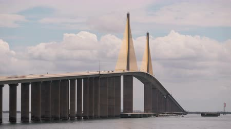 tampa bay : (Time-lapseZoom-in) Traffic crosses the Sunshine Skyway Bridge over Tampa Bay as viewed from the north fishing pier.