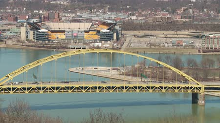 heinz : Traffic crosses the Fort Pitt Bridge over the Monongahela River in and out of downtown Pittsburgh, Pennsylvania. Stock Footage