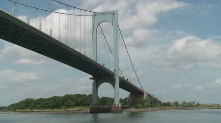 bronx : The view from a boat sailing under the Bronx-Whitestone Bridge on the East River in New York City. Stock Footage