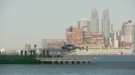 heliport : JERSEY CITY - MARCH 9: A helicopter lands at the Paulus Hook Pier Heliport on March 9, 2013 in Jersey City.