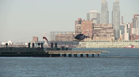 heliport : JERSEY CITY - MARCH 9: A helicopter takes off from the Paulus Hook Pier Heliport on March 9, 2013 in Jersey City.