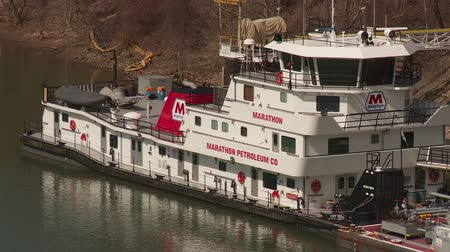 ancorado : INDUSTRY, PA - MARCH 31: Marathon Petroleum towboat (pushboat) Marathon sits docked on the Ohio River on March 31, 2013 at the IndustryMidland, Pennsylvania facility.