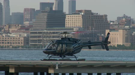 heliport : JERSEY CITY - JUNE 23: A pilot sits in a helicopter after landing at the Paulus Hook Pier Heliport on June 23, 2013 in Jersey City.