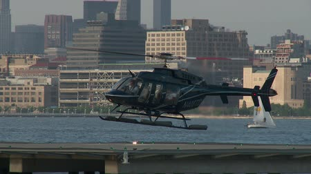 heliport : JERSEY CITY - JUNE 23: A helicopter lands at the Paulus Hook Pier Heliport on June 23, 2013 in Jersey City.