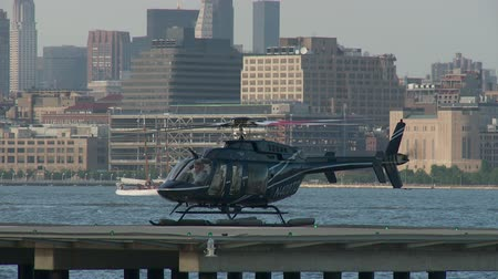 heliport : JERSEY CITY - JUNE 23: A helicopter powers down after landing at the Paulus Hook Pier Heliport on June 23, 2013 in Jersey City.