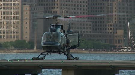 heliport : JERSEY CITY - JUNE 23: A pilot and ground crew member prepare a helicopter for departure at the Paulus Hook Pier Heliport on June 23, 2013 in Jersey City. Stock Footage