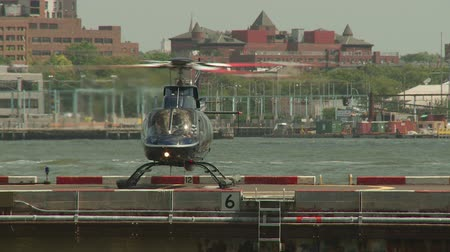 heliport : NEW YORK - JULY 14: A helicopter readies for takes-off at the Downtown Manhattan Heliport on July 14, 2013 in New York City. Stock Footage