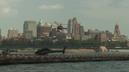heliport : NEW YORK - JULY 14: A helicopter lands at the Downtown Manhattan Heliport on July 14, 2013 in New York City.