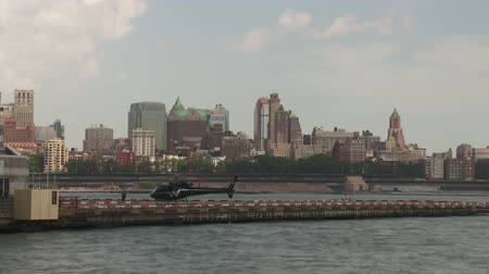 heliport : NEW YORK - JULY 14: (Time-lapse) Helicopter take-off and land at the Downtown Manhattan Heliport on July 14, 2013 in New York City.