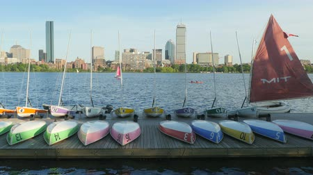 kuzey amerika : CAMBRIDGE, MA - JUNE 3: Colorful sailboats and dinghies sit on the dock of the MIT Sailing Pavilion on the Charles River on June 3, 2015 in Cambridge.