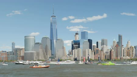 world cup : NEW YORK - MAY 8: Louis Vuitton Americas Cup World Series team catamarans race on the Hudson River course surrounded by spectator boats, with the Freedom Tower and lower Manhattan skyline in the background on May 8, 2016 in New York.