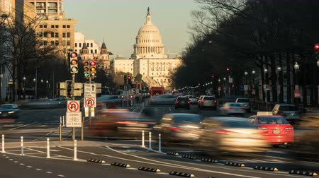 (Time-lapse) Traffic moves on Pennsylvania Avenue, with the US Capitol building in the background, in Washington, DC. Stock Footage