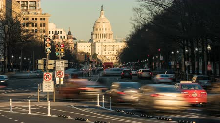 (Time-lapseZoom-in) Traffic moves on Pennsylvania Avenue, with the US Capitol building in the background, in Washington, DC. Stock Footage