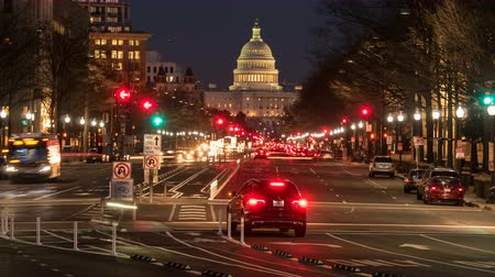 (Time-lapseZoom-in) Traffic moves on Pennsylvania Avenue, with the US Capitol building in the background, during evening twilight in Washington, DC. Stock Footage