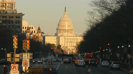 WASHINGTON - MARCH 23: Traffic flows on Pennsylvania Avenue, with the US Capitol building in the background on March 23, 2017 in Washington, DC. Stock Footage
