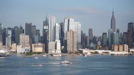 The midtown Manhattan skyline in New York City as viewed from New Jersey across the Hudson River.