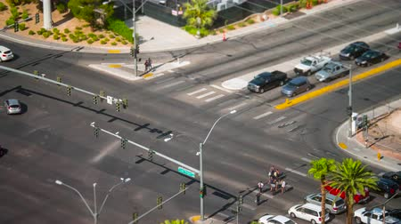 PARADISE, NV - AUGUST 8: (Time-lapse) Vehicular traffic and pedestrians pass through an intersection on Las Vegas Boulevard (The Strip) in Paradise (Las Vegas), Nevada in a tilt-shift miniature effect view on August 8, 2017 in Paradise