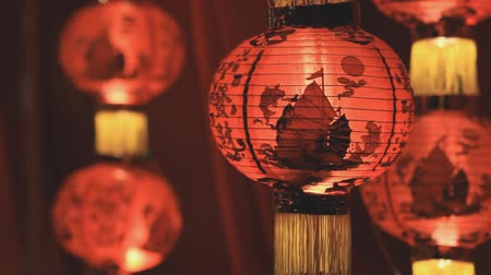 ano novo chinês : Chinese paper lanterns in the night on Chinese new year celebration Vídeos