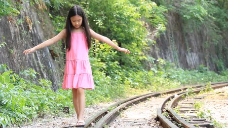 asian family : Little Asian girl walk on the railway Stock Footage