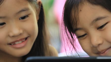 таблетка : Close up of Asian child using tablet together