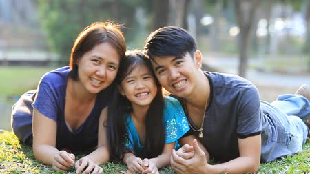 asian family : Happy Asian family playing together in park Stock Footage
