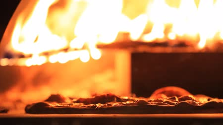 wood : Pizza in a wood fire oven Stock Footage