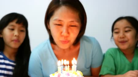 asian family : Slow motion happy moment of Asian family blowing birthday candles Stock Footage