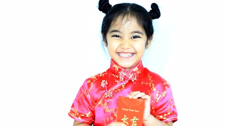 cultura juvenil : Happy little Asian Chinese child surprising with red envelop, Chinese new year