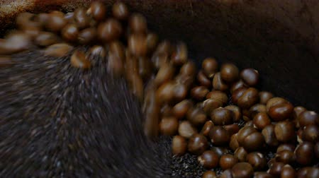 proceed : Roast chestnuts in chestnut roasting machine : 4K Video Stock Footage