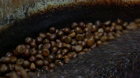 proceed : Roast chestnuts in chestnut roasting machine, Pan shot : 4K Video