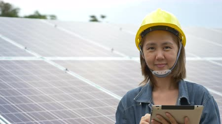 painel : Asian engineer checking solar panel setup