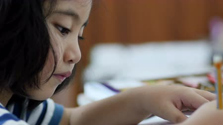 asya : Asian student doing exam in classroom