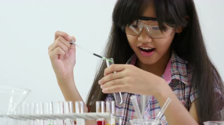 maior : Little Asian student girl making science experiments. Education Vídeos