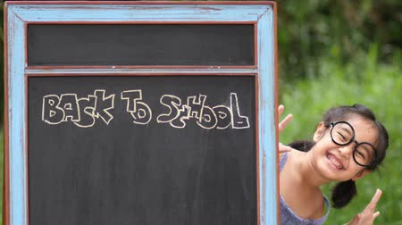 okula geri : Adorable little Asian school girl behide the blackboard