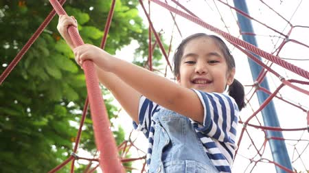 sport dzieci : Little Asian child climb on play equipment