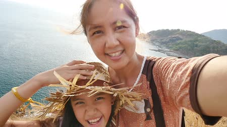 asian family : Asian mother and daughter taking selfie photograph together, Happy family concept, Slow motion shot.