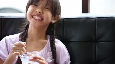 snack : Happy Asian girl enjoy eating ice-cream Stock Footage
