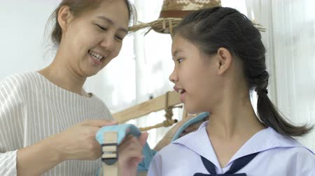 getting ready : 4K : Asian mother helping hers young daughter prepare to school