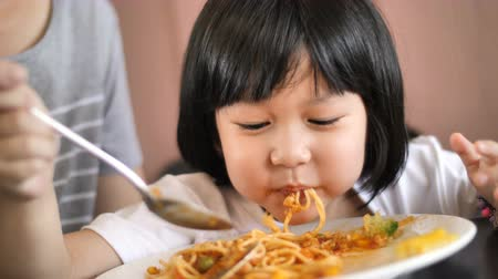 spagetti : Slow motion 4K Happy Asian child eating delicious spaghetti
