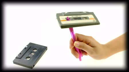 kompakt : Women use pen rewind a cassette tape  on white background Stok Video