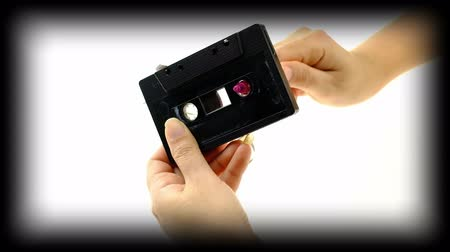 casette : Women use pen rewind a cassette tape  on white background Stock Footage