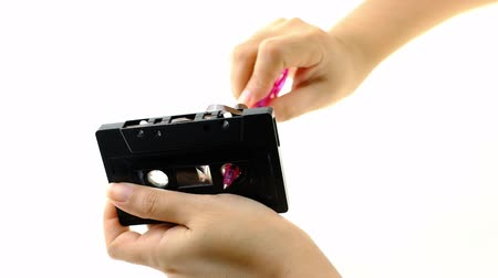 cassette : Women use pen rewind a cassette tape  on white background Stock Footage