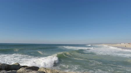 chapel : heavy waves touching atlantic beach in Portugal